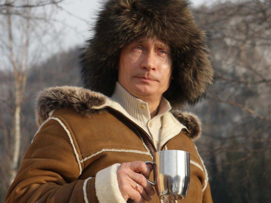Russia's Prime Minister Vladimir Putin holds a cup, 2010. REUTERS/Ria Novosti/Alexei Druzhinin.