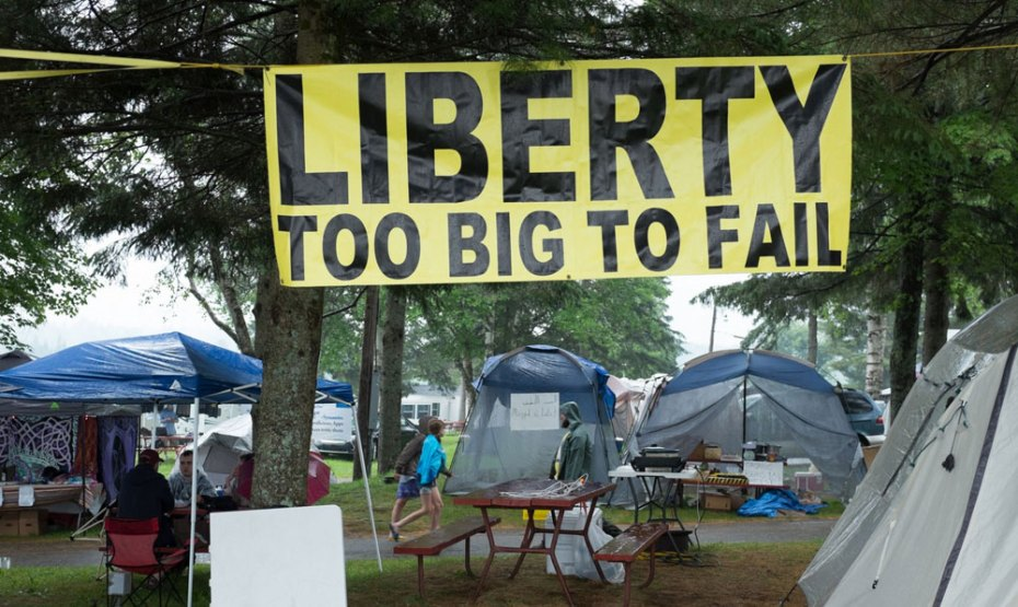 June 25, 2014: A banner hangs in the camping area at the Porcupine Freedom Festival, or PorcFest. Matthew Cavanaugh for The Washington Post.