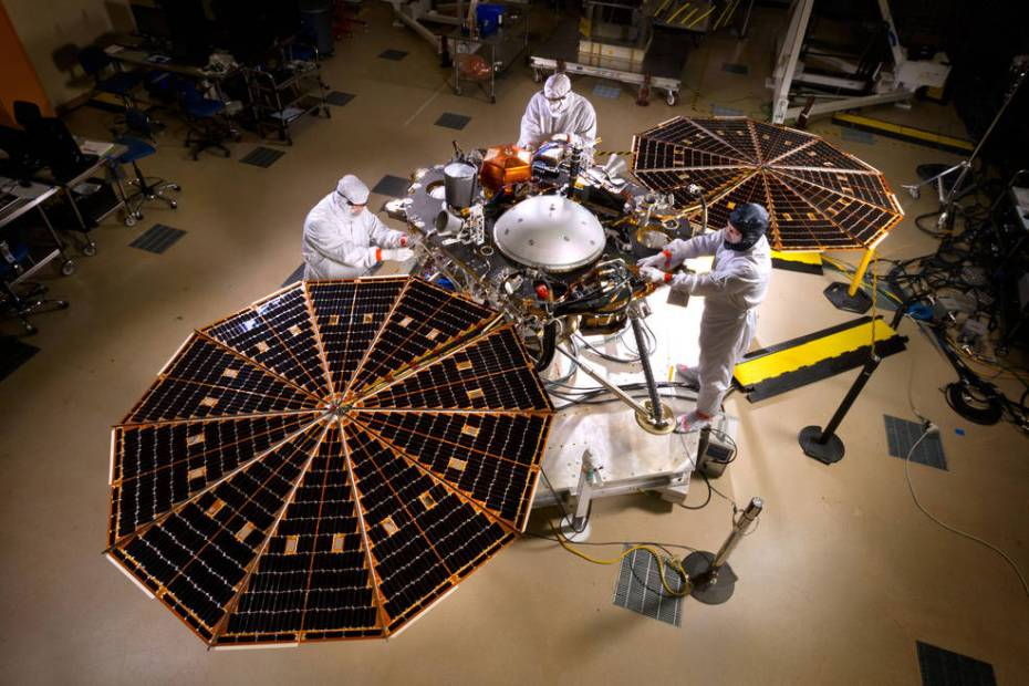 NASA's InSight Mars lander spacecraft in a Lockheed Martin clean room near Denver. As part of a series of deployment tests, the spacecraft was commanded to deploy its solar arrays in the clean room to test and verify the exact process that it will use on the surface of Mars. [NASA]