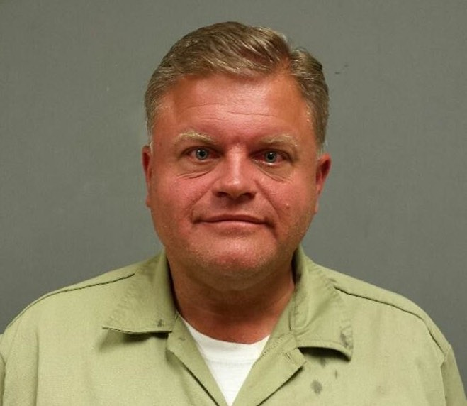 Pastor Holder's mugshot, from his most recent brush with the law. Image: Kingston Police.