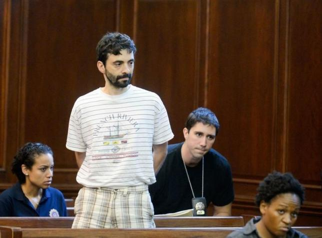 Former Goldman Sachs computer programmer Sergey Aleynikov (2nd L) waits to appear in Manhattan Criminal Court at New York, in this file photo taken on August 9, 2012. REUTERS/STEVEN HIRSCH/POOL