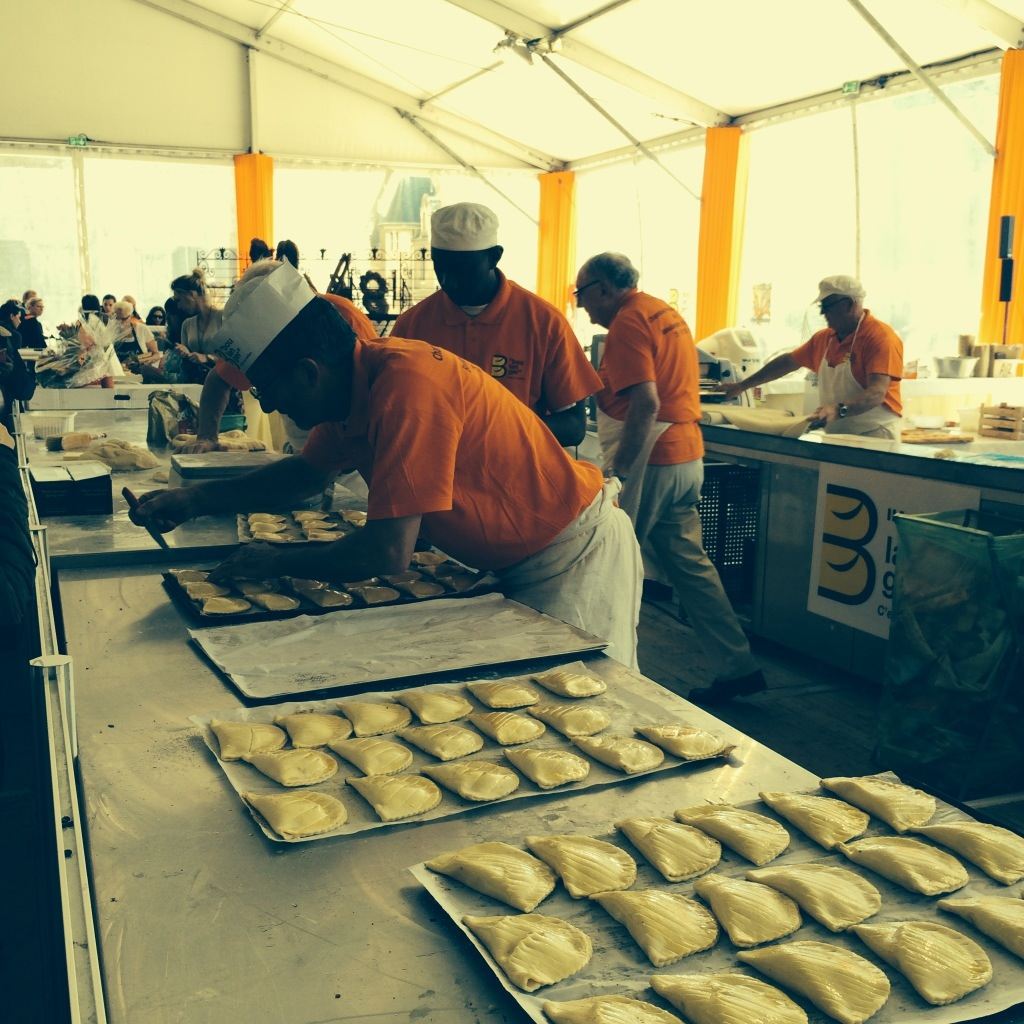 Scores of bakers preparing pastries and breads