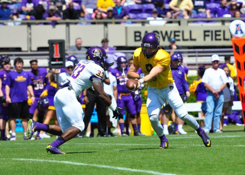 Senior QB Philip Nelson hands off to sophomore RB Shawn Furlow at the Purple-Gold Spring Game (W.A. Myatt photo)