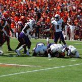 ECU defenders combine to stop Virginia Tech's Travon McMillan on a third down. (Photo by Al Myatt)