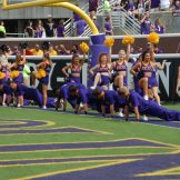 Cheerleaders get their push-ups in after an ECU score.