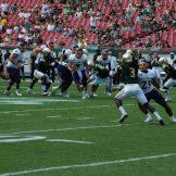 East Carolina quarterback Philip Nelson scrambles as Quay Johnson looks to provide a block downfield.
