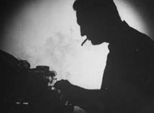 man-smoking-at-typewriter