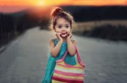 child-with-purse-sunset-free-use