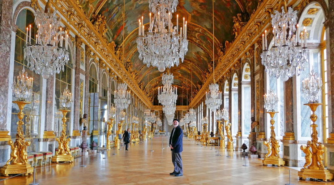 Sole visitor in the Hall of Mirrors in the Palace of Versailles