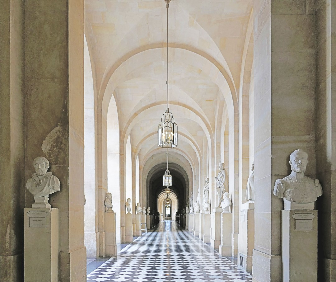See the symmetry in this hallway of busts at the Palace of Versailles