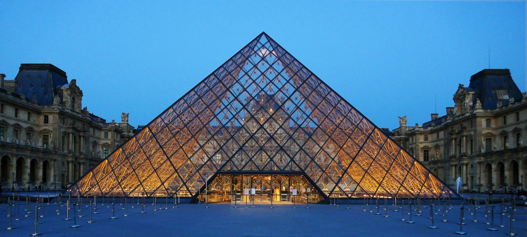 Louvre pyramid in Paris at sunset