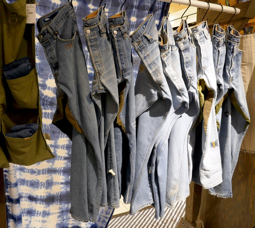 Rack of faded jeans at pop-in at Nordstrom