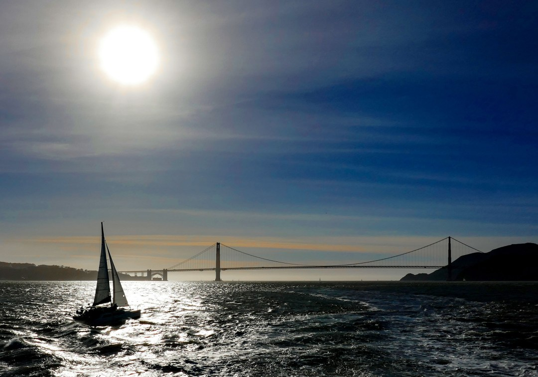 Sailing at sunset at Golden Gate Bridge