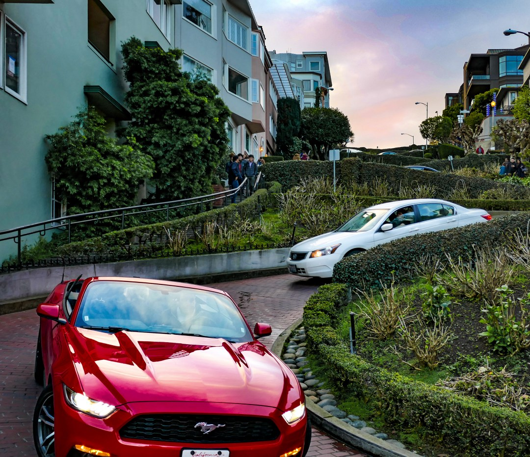 Red Mustang convertible on Lombard Street for boomervoice