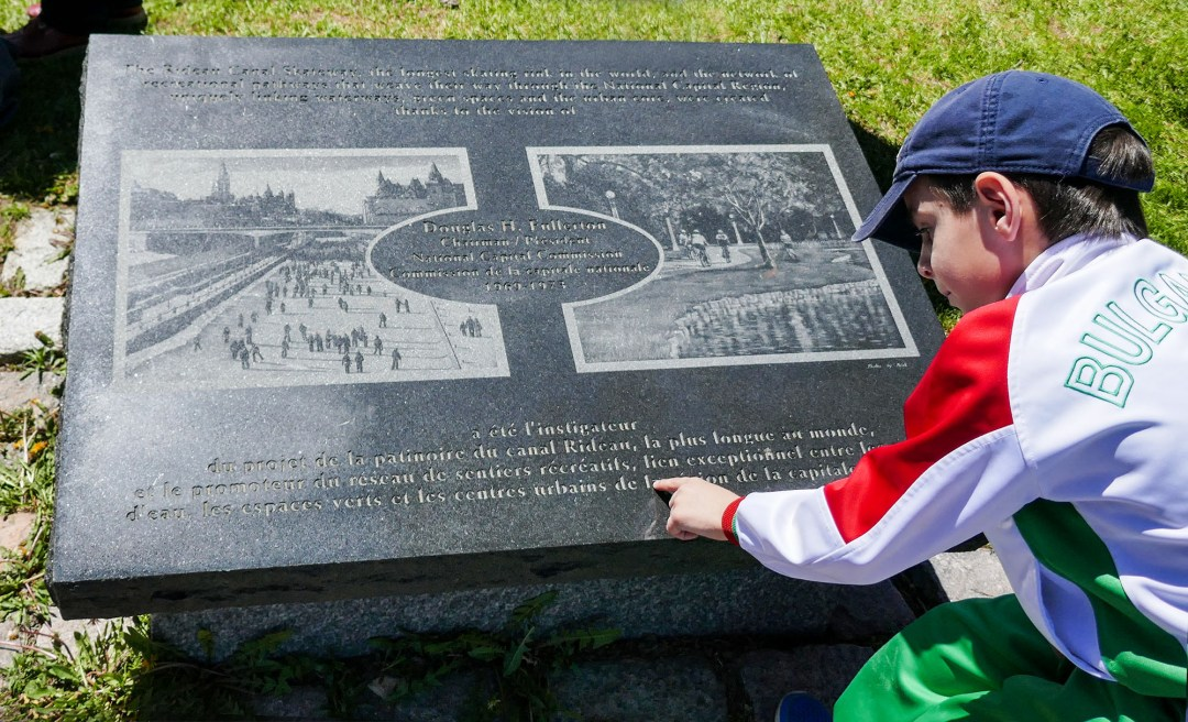 Boy reading Rideau Canal sign for boomervoice
