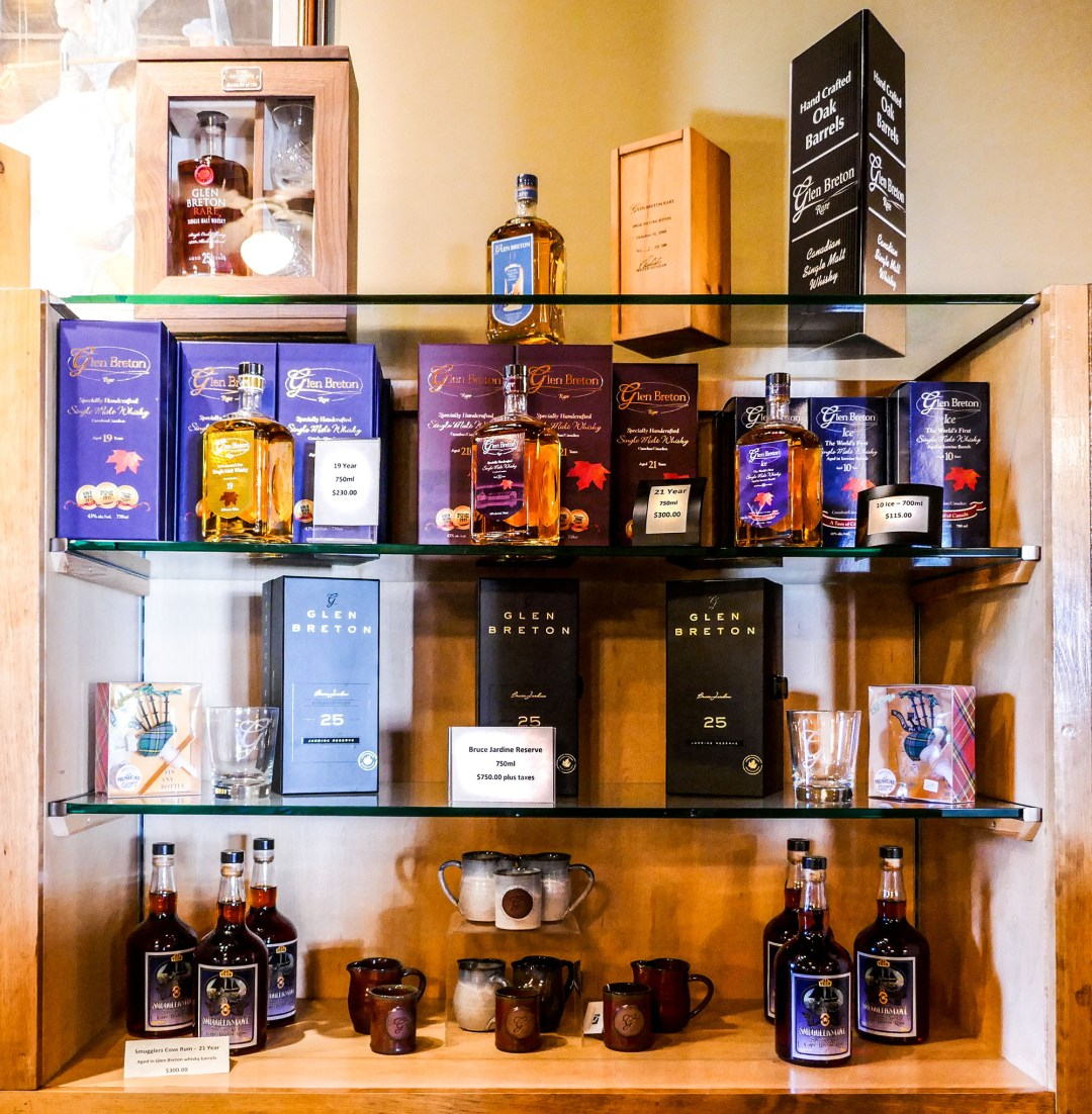 Display of whiskies at Glenora Distillery for boomervoice
