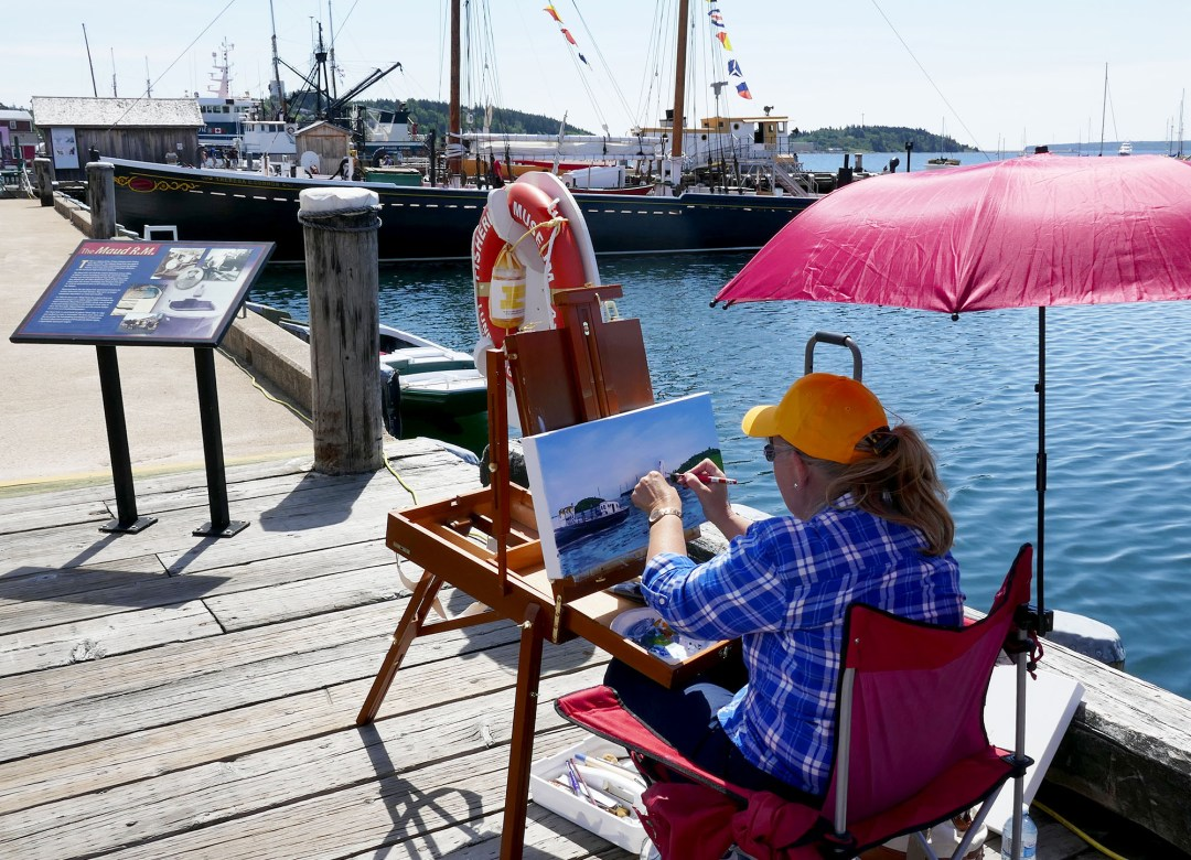 Artist on boardwalk in Lunenburg for boomervoice
