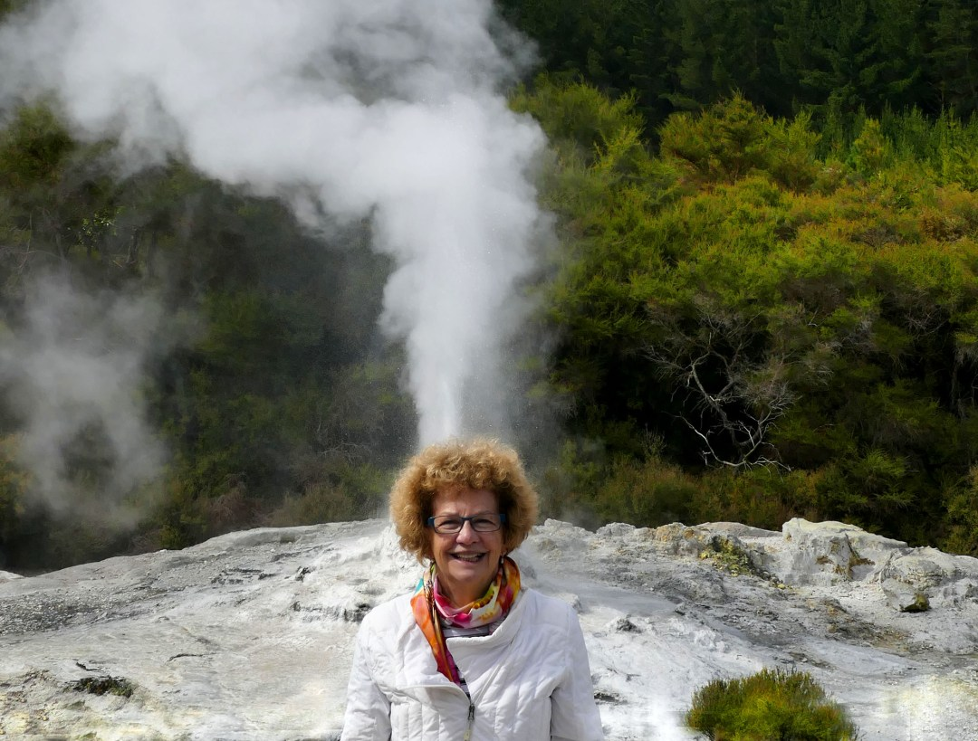 Geyser and geezer at Waiotapu Geothermal Park near Rotorua New Zealand for boomervoice
