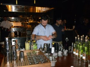 Christopher James mixing his pisco sour