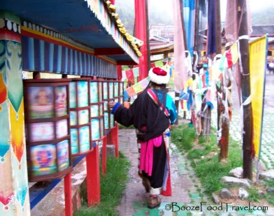 Tibetan woman spinning the prayer wheels