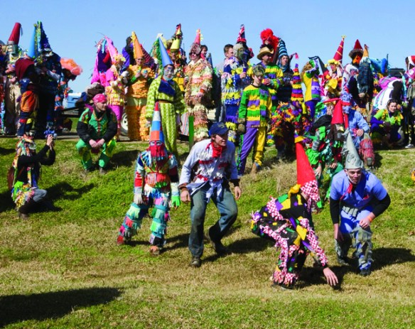 A courir de Mardi Gras begs for gumbo ingredients at a farm in Southwest Louisiana's Cajun Country. Credit: Philip Gould.