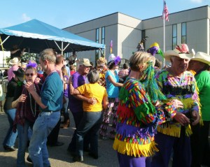 On Mardi Gras afternoon,, a crowd of locals and visitors dance to the music of Steve Riley and the Mamou Playboys.