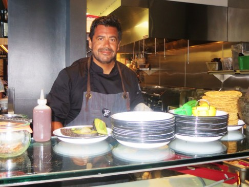 Chef/Owner Javier Plascencia behind the seafood bar