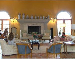 The living room, as are all the rooms in the main house, is built on a grand scale, yet manages to be comfy and inviting.