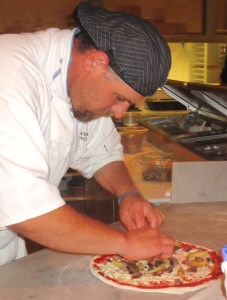 Chef Andrea creating a pizza masterpiece.