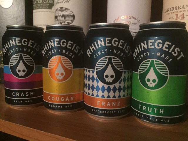 Rhinegeist Crash, Cougar, Franz, and Truth cans in a line.