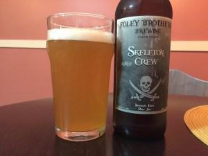 Folly Brothers Brewing Skeleton Crew Imperial IPA poured into a nonic pint glass.