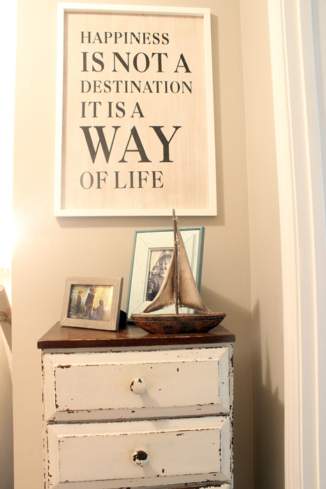 vignette in A-frame hallway with Happiness sign