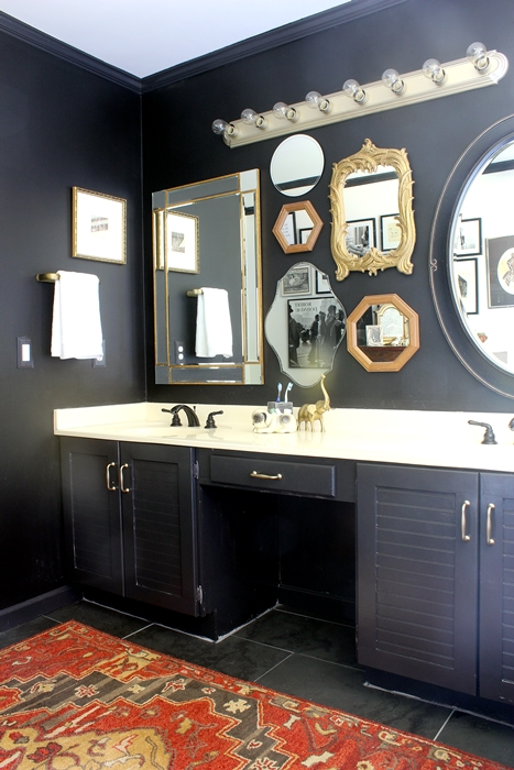 black cabinets and black wall in bathroom