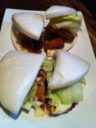 Hirata Buns - Steamed buns filled with pork, served with Ippudo's original spicy buns sauce