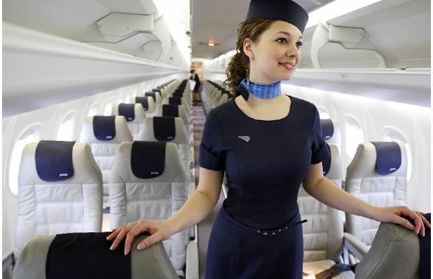 Porter flight attendant inside Porter plane