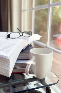 15974-a-cup-of-coffee-with-a-stack-of-books-pv