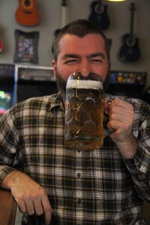 Paul enjoying a large beer.