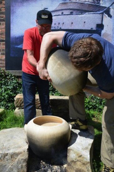Brewers at Great Lakes Brewing using Sumerian style clay pots.