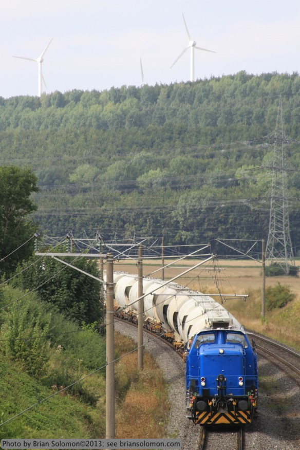 A diesel leads a train of limestone hoppers near Neurath. September 2012. Canon EOS 7D photo.