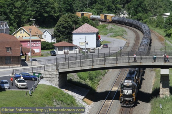 On July 1, 2010, a pair of recently remanufactured Norfolk Southern 'SD40Es' shove on the back of heavy westward freight 17G  at Gallitzin, Pennsylvania. Norfolk Southern has rebuilt a number of 1980s-era SD50s. Work has included downgrading the 3,500 hp 16-645F engine to 3,000 hp 16-645E3C configuration while replacing the electrical system with modern microprocessor controls.