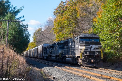 Norfolk Southern SD60E leads an east auto rack train at Lake Pleasant, Massachusetts.