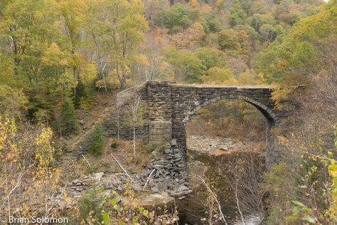 New York Central abandoned about a mile of the original Western Rail Road grade when it completed its line relocation in 1912. This one of three extant stone arch bridge on the abandoned section.