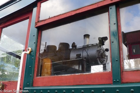 Steam locomotive number 60 reflects in the windows of doodlebug M-55 at Ringoes, New Jersey. Lumix LX7 photo.