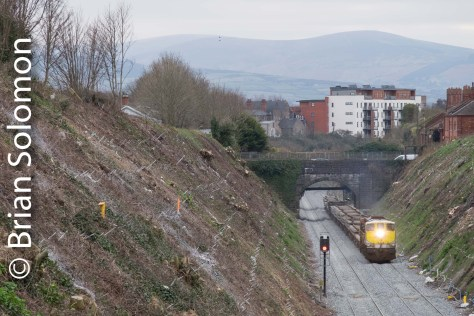 The roar of engine 072 is accentuated by the cutting. The new wide open view allows for a great panorama with the Wicklow Mountains in the distance.