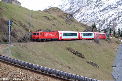 In mid-April, my friends and I visited Andermatt and were fortunate to catch this charter of Glacier Express equipment descending the rack railway grade toward Andermatt.