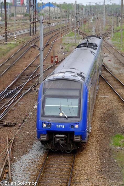 An SNCF train approaches Gare de Valenciennes.