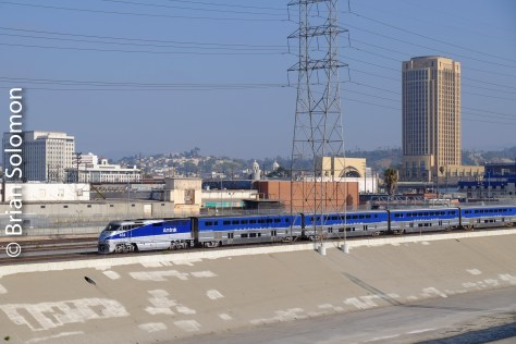 On its way to San Diego, Amtrak's Pacific Surfliner against the LA skyline.