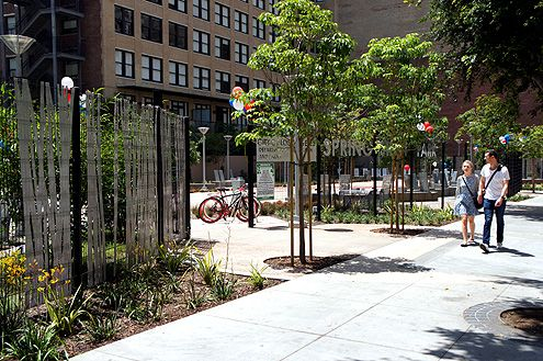 The new Spring Street Park, which replaced an ugly surface parking lot, now provides a pleasant walk along the sidewalk