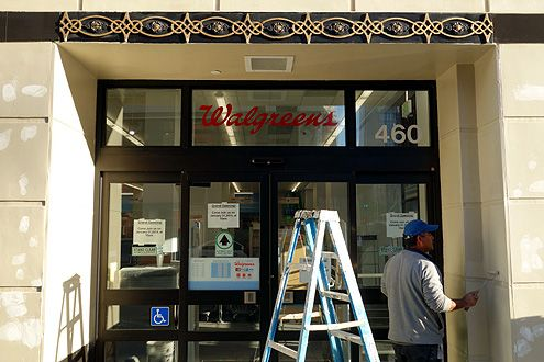 Workers were seen adding the finishing touches of paint to the store facade