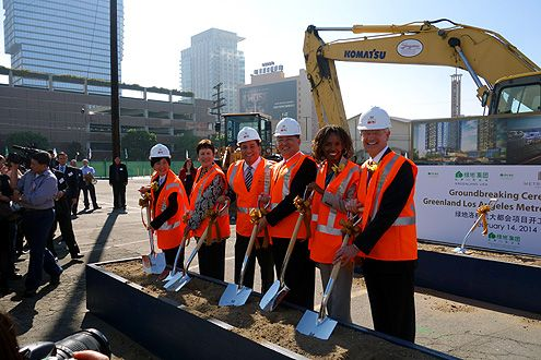 The developer is joined by city officials and business leaders for the ceremonial ground breaking of Metropolis